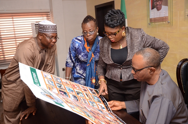 Governor Mimiko looking at Past Rise Networks Event Photo Collage