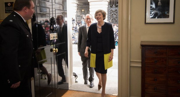 New Prime Minister Theresa May, followed by her husband Philip John, walks into 10 Downing Street, London, after meeting Queen Elizabeth II and accepting her invitation to become Prime Minister and form a new government. PRESS ASSOCIATION Photo. Picture date: Wednesday July 13, 2016. See PA story POLITICS Conservatives. Photo credit should read: Stefan Rousseau/PA Wire